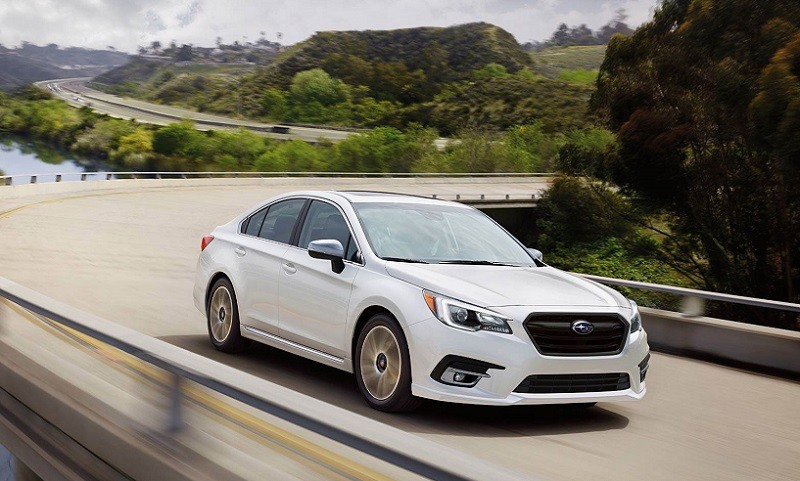 view of white 2018 Subaru Legacy on the road