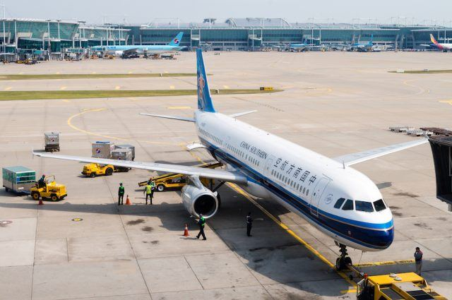 A China Southern Airlines plane being serviced on the tarmac of Tokyo Narita Airport