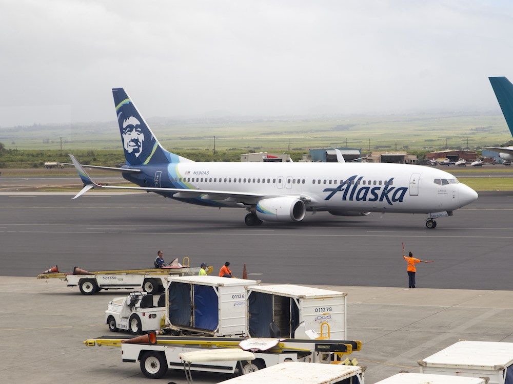 An Alaska Airlines plane taxiing to the gate