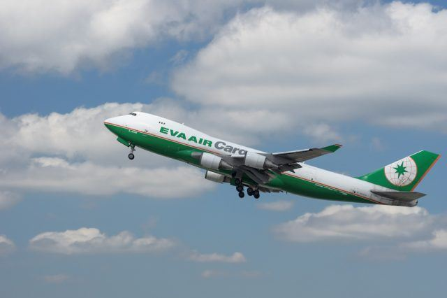 An EVA Air Cargo jumbo jet (Boeing 747-400) is shown departing the Los Angeles International Airport (LAX) in California