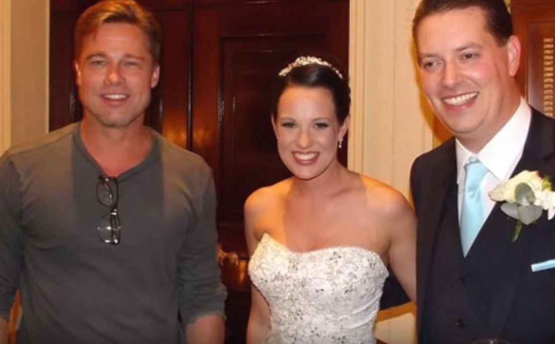Brad Pitt poses with the newlyweds.