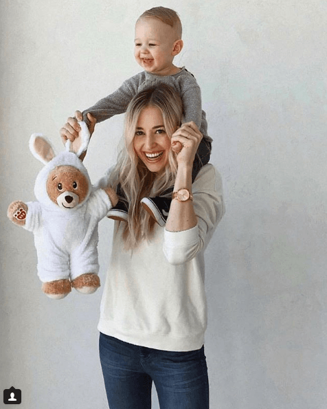 A woman and her son holding a Build-A-Bear toy