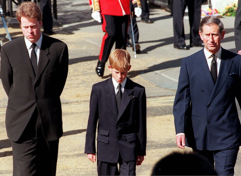 Earl Spencer, Diana's brother, Prince Harry, her son, and Prince Charles, her former husband, join the gun carriage carrying the coffin