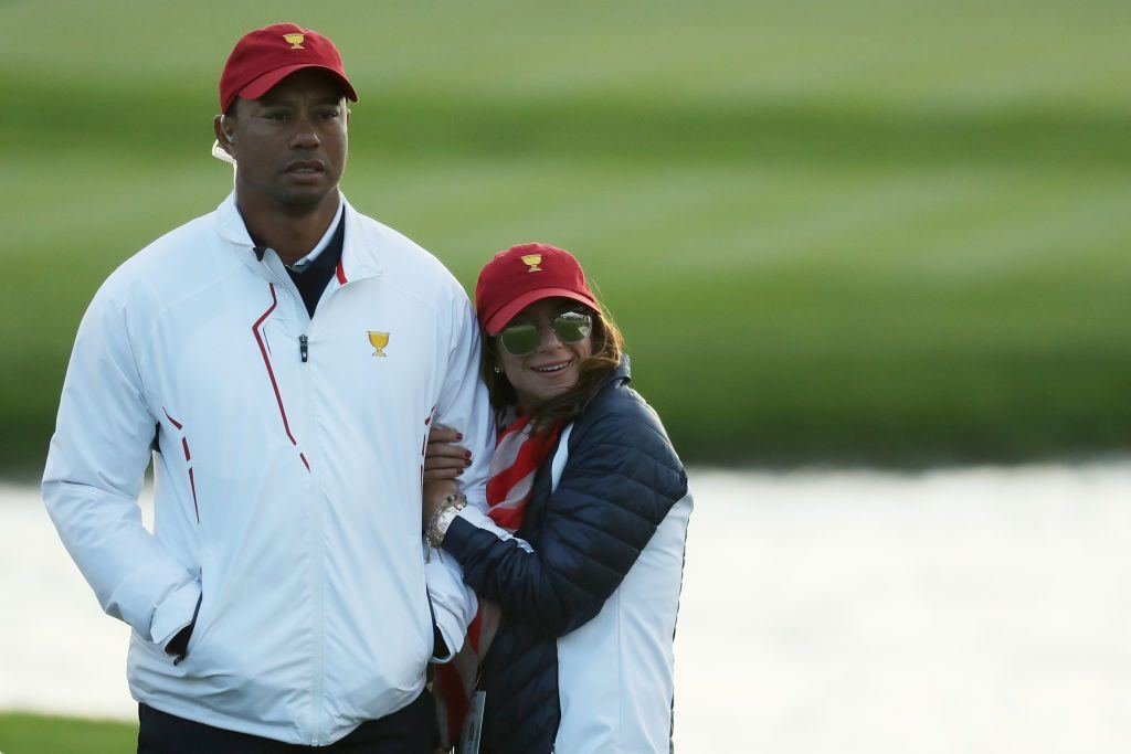 Tiger Woods of the U.S. Team and Erica Herman
