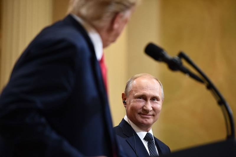 US President Donald Trump and Russia's President Vladimir Putin attend a joint press conference after a meeting at the Presidential Palace in Helsinki, on July 16, 2018.
