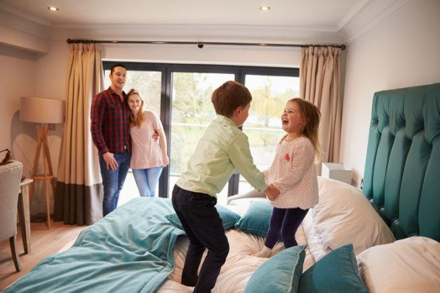 Family in hotel room on vacation