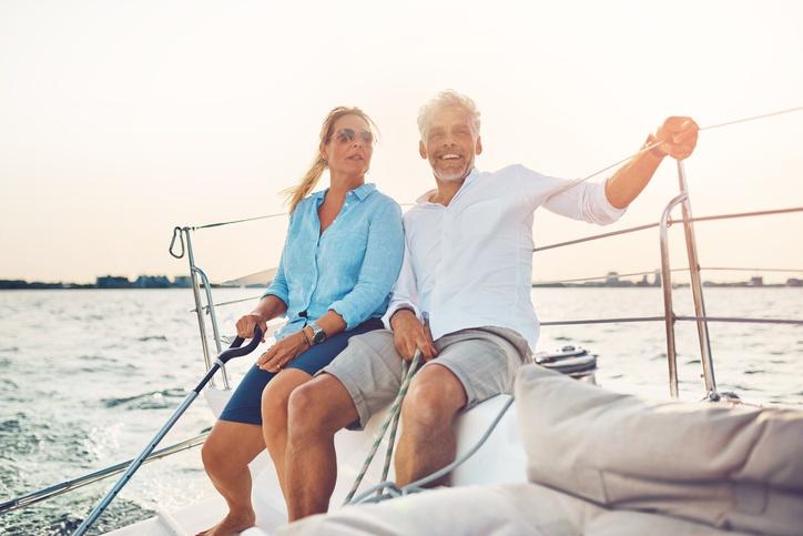 Happy couple sailing retirement