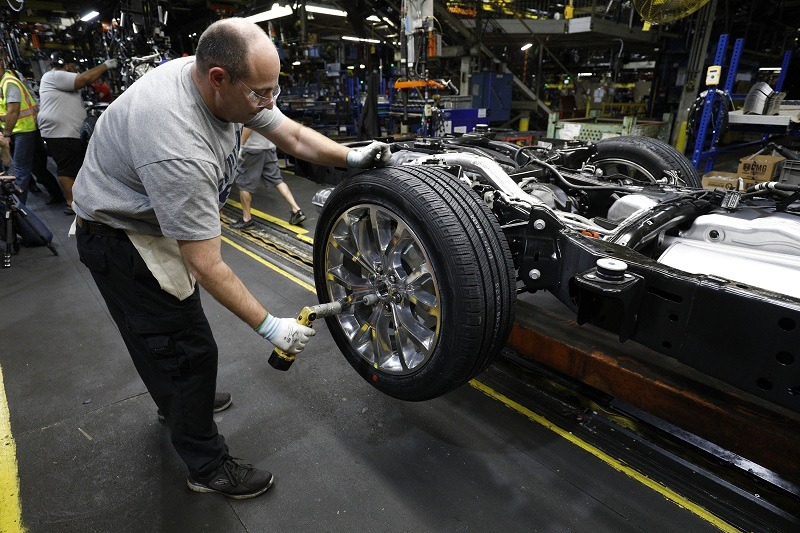 LOUISVILLE, KY - OCTOBER 27: A worker builds the all-new 2018 Ford Expedition SUV as it goes through A look at the assembly line at the Ford Kentucky Truck Plant October 27, 2017 in Louisville, Kentucky.