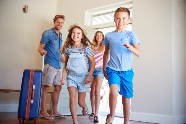 Family arriving at vacation rental