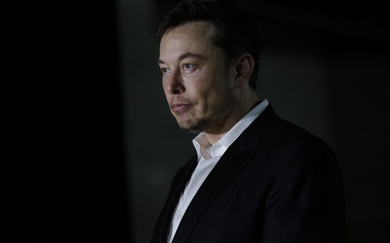 Engineer and tech entrepreneur Elon Musk of The Boring Company listens as Chicago Mayor Rahm Emanuel talks about constructing a high speed transit tunnel at Block 37 during a news conference on June 14, 2018 in Chicago, Illinois. Musk said he could create a 16-passenger vehicle to operate on a high-speed rail system that could get travelers to and from downtown Chicago and O'hare International Airport under twenty minutes, at speeds of over 100 miles per hour.