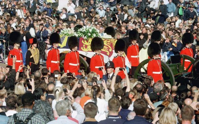 Guardsmen escort the coffin of Princess Diana, draped in the Royal Standard