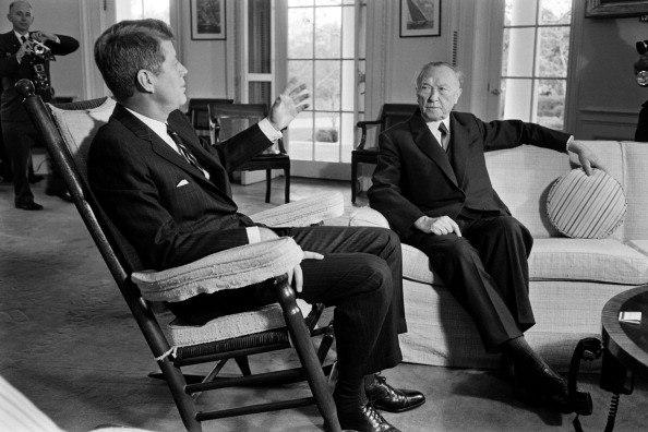 German Chancellor Konrad Adenauer (R) listens to U.S. President John F. Kennedy (L)
