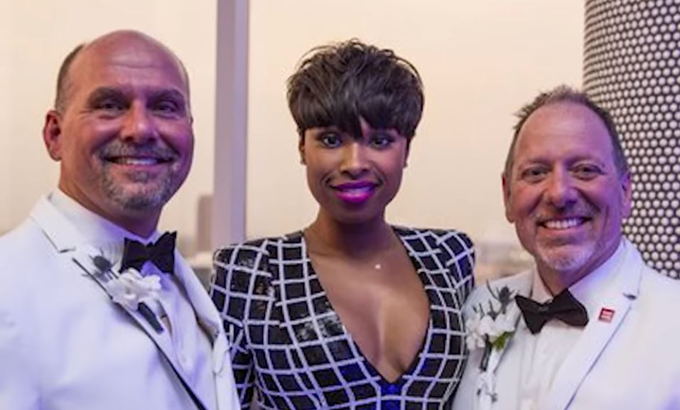 Jennifer Hudson poses with the grooms.