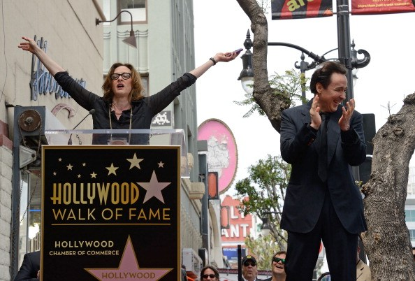 Actress Joan Cusack (L) speaks before her brother John Cusack received a star on the Hollywood Walk of Fame