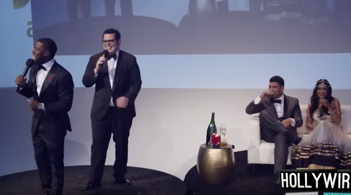 The newlyweds laugh during Kevin Hart and Josh Gad's cameo.
