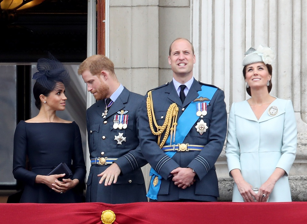 Meghan Markle, Prince Harry, Prince William, and Kate Middleton watch the RAF flypast on the balcony of Buckingham Palace