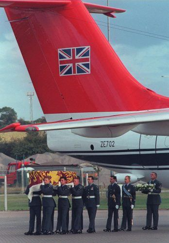 Military pall-bearers carry the casket containing the body of Diana, Princess of Wales from the aircraft to a waiting hearse at RAF Northolt