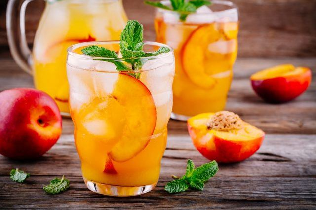 Peach ice tea with ice cubes