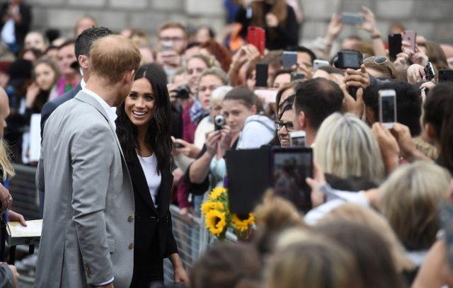 Prince Harry, Duke of Sussex and Meghan, Duchess of Sussex visit Trinity College