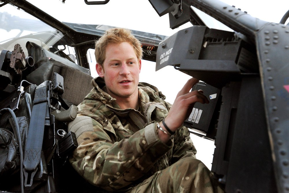 Prince Harry makes early morning checks as he sits on an Apache helicopter