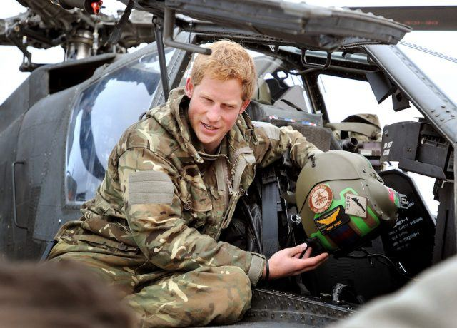 Prince Harry makes early morning checks as he sits on an Apache helicopter at the British controlled flight-line at Camp Bastion in Afghanistan