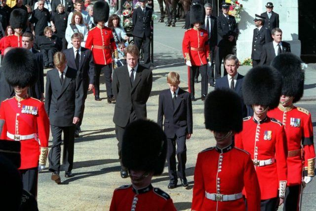 Prince William, Earl Spencer, Prince Harry and Prince Charles are led by a party of Foot guards to Princess Diana's funeral
