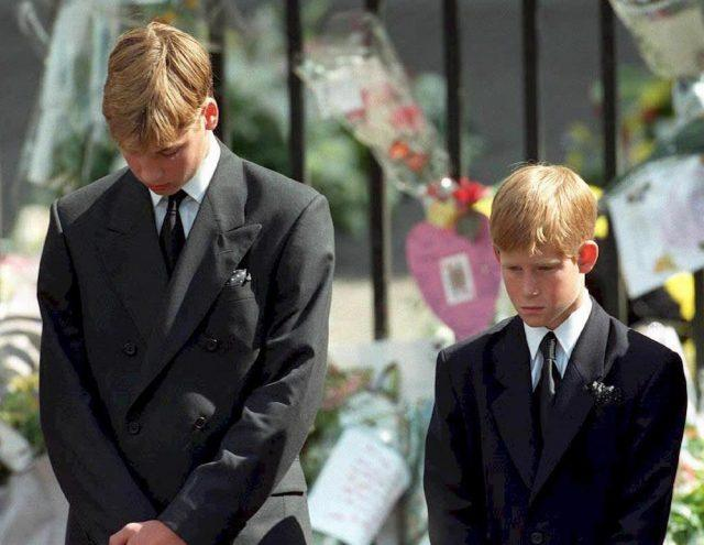 Prince William and Prince Harry bow their heads as their mother's coffin is taken out of Westminster Abbey
