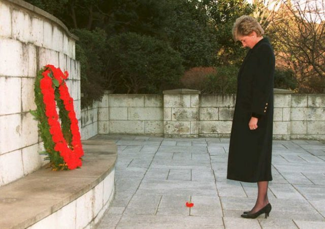 Princess Diana stands in silence after laying a wreath at a memorial to the war dead of the British Commonwealth