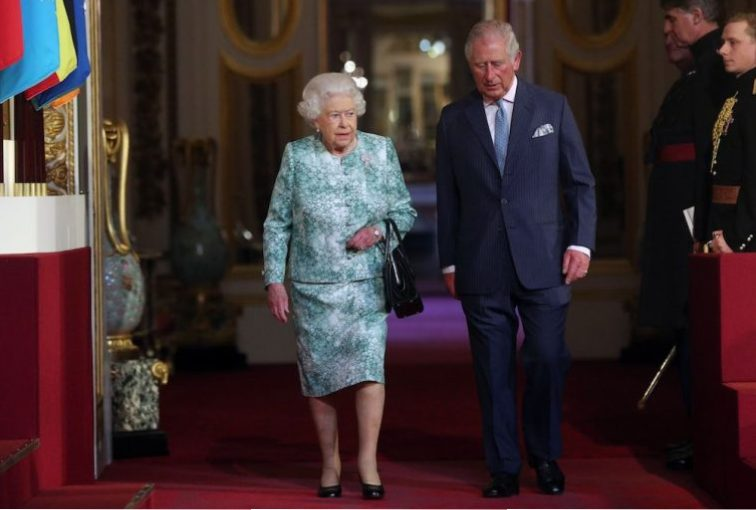 Queen Elizabeth II and Prince Charles arrive for the formal opening of the Commonwealth Heads of Government Meeting at the ballroom at Buckingham Palace