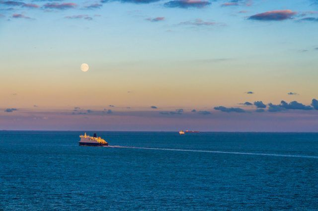 Distant ships crossing the English Channel at twilight