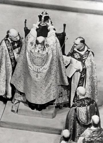 The Archbishop of Canterbury places St. Edward's Crown on the head of Queen Elizabeth II