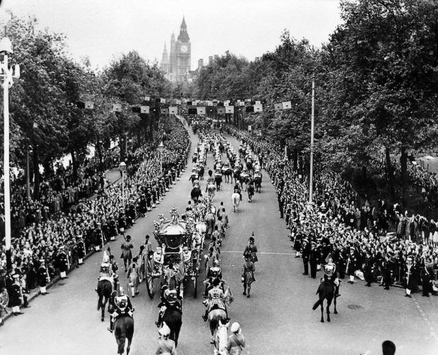 The royal carriage of Queen Elizabeth II passes along Victoria Embankment