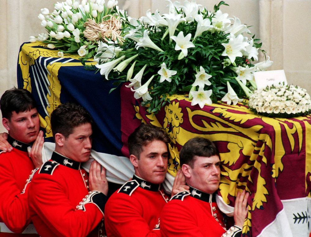 Welsh guards carry the coffin out of Westminster Abbey after Princess Diana's funeral