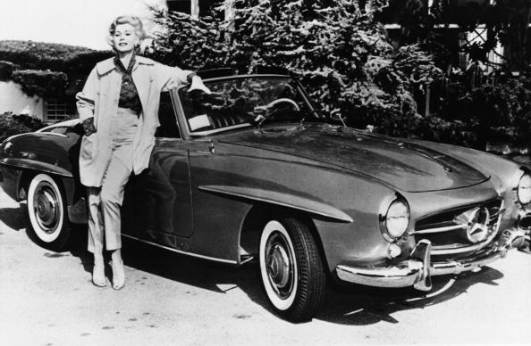 US actress Zsa Zsa Gabor poses on May 12, 1958, in front of her Mercedes car