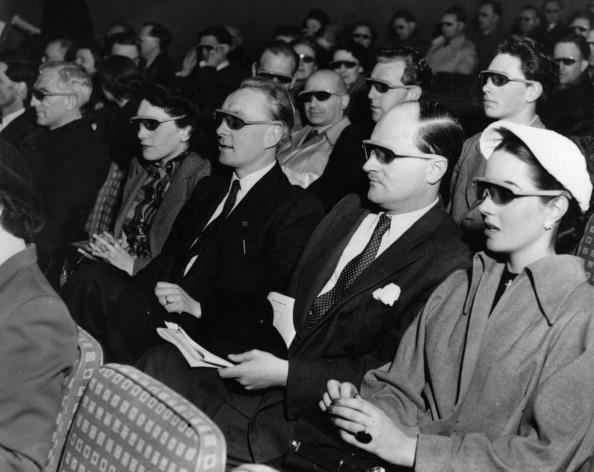 Cinema-goers wearing 3D glasses at a special Festival of Britain three dimensional film screening