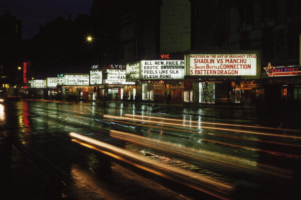 Cinema signs advertising adult and martial arts films on 42nd Street, New York, circa 1977