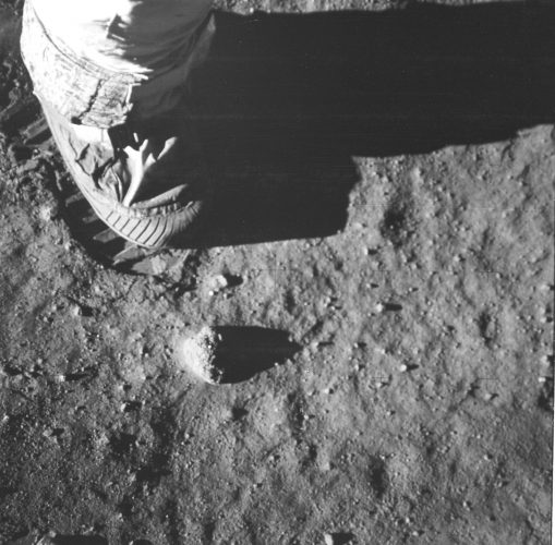 An Apollo 11 astronaut's foot and footprint in the lunar soil