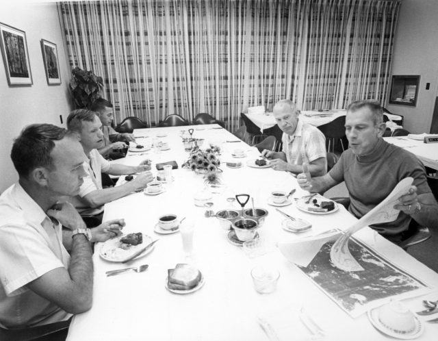 Apollo 11 astronauts review lunar charts before the first moon landing