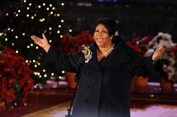 Aretha Franklin performs onstage at attends the Rockefeller Center Christmas tree lighting at Rockefeller Center on December 2, 2009 in New York City