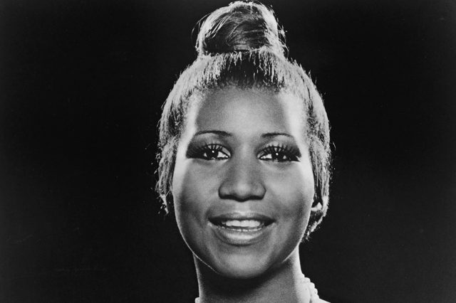 Portrait of American soul singer Aretha Franklin as she wears a strapless dress and pearl necklace and has her hair in a bun, 197