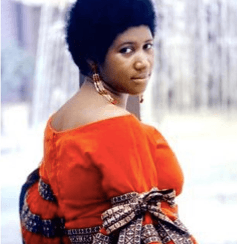 Aretha Franklin in a red dress