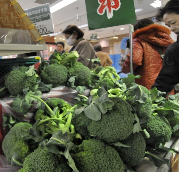 Shoppers buy broccoli sprouts at a supermarket in Tokyo