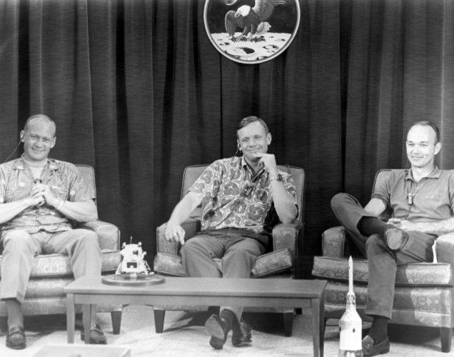 Buzz Aldrin, Neil Armstrong, and Michael Collins conduct a press conference