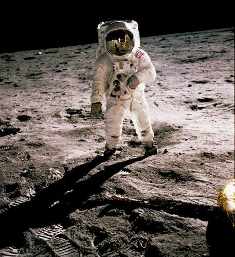 Buzz Aldrin during the first moon landing, with Neil Armstrong reflected in his visor