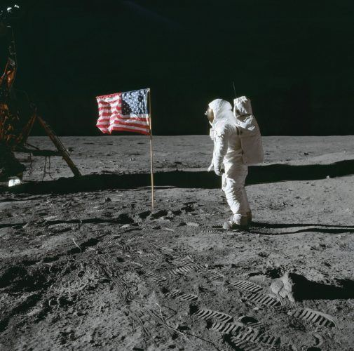 Buzz Aldrin poses beside the deployed United States flag during Apollo 11 extravehicular activity on the lunar surface