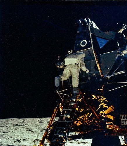 Buzz Aldrin prepares to take his first steps on the moon