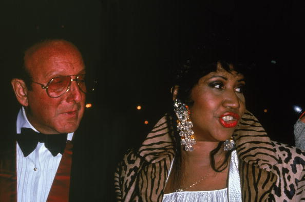 American music executive Clive Davis and American soul singer Aretha Franklin attend an event, 1992. Franklin wears a leopard fur coat