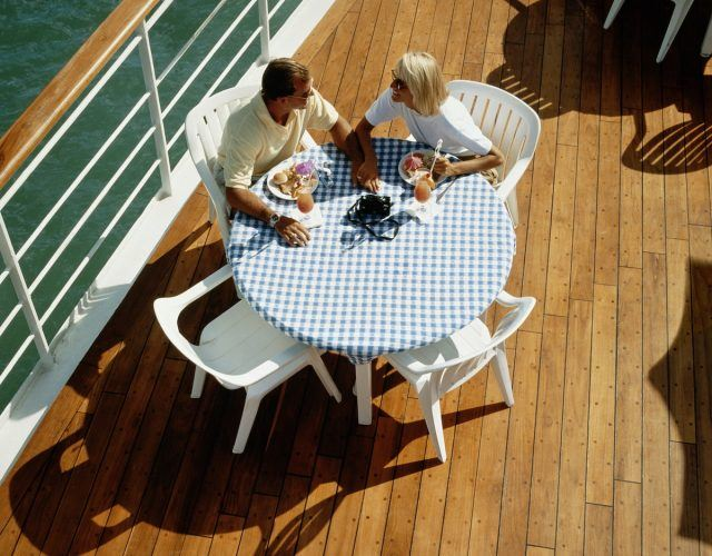 Couple has lunch on the deck of a cruise ship