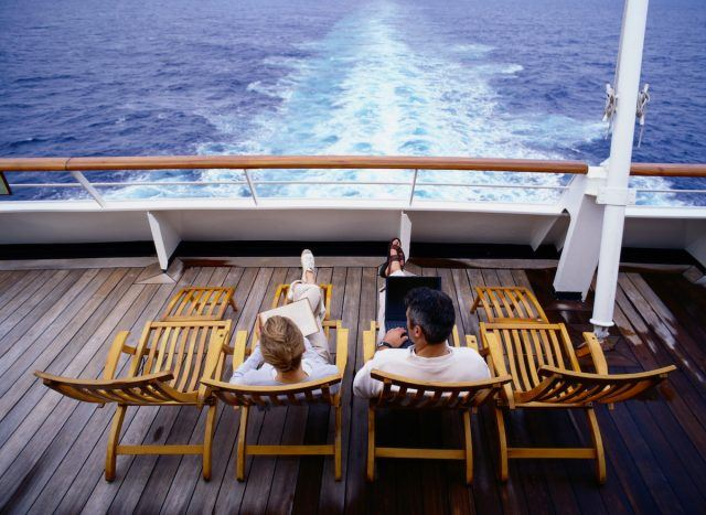 Couple on deck chairs on a cruise