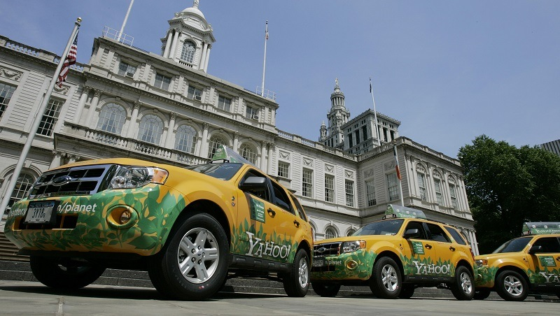 Three Ford Escape hybrid taxicabs donated by Yahoo! in front of New York's City Hall, 22 May 2007, as New York City Mayor Michael Bloomberg announced that the city's taxi fleet will be fully hybrid by 2012. The Taxi and Limousine Commission will implement new emissions and mileage standards phased in over the next four years for the more than 13,000 yellow taxicabs in New York.